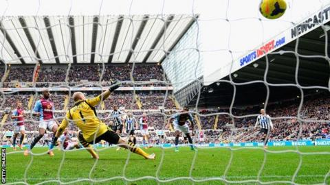 Newcastle striker Loic Remy shoots past keeper Brad Guzan for his side's winner against Aston Villa