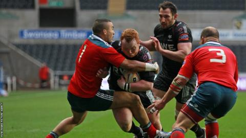 Munster wing Simon Zebo brings down Ospreys prop Dan Suter in the Pro12 at Liberty Stadium