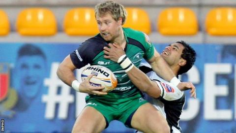 Fionn Carr is tackled by Dion Berryman in Italy