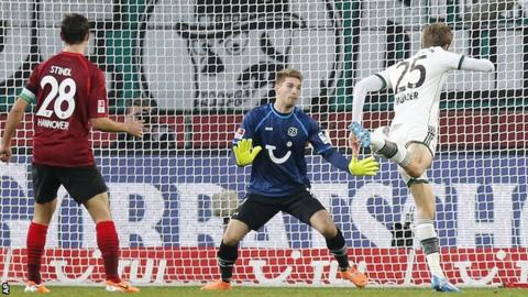 Thomas Muller heads in a goal as he sets Bayern Munich on their way to victory over Hannover 96