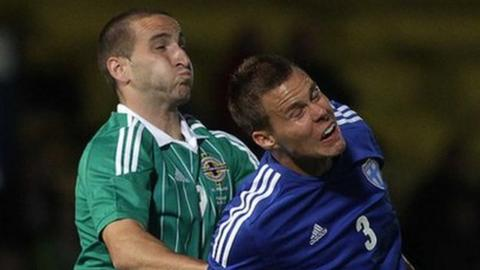 Martin Paterson battles with Finland's Niklas Moisander in the 2012 friendly at Windsor Park