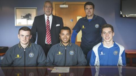 Back row: Roland Wycherley (Shrewsbury Town chairman), Mike Jackson (manager). Front row: Callum Burton, Dom Smith, Harry Lewis
