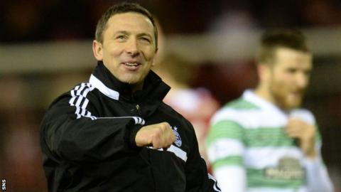 Derek McInnes celebrates Aberdeen's win
