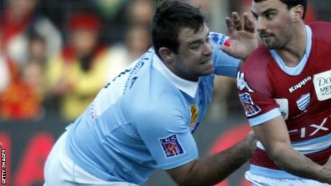 Leicester's Jerome Schuster, in his Top 14 days with Perpignan, tackles Racing Metro full-back Juan Imhoff