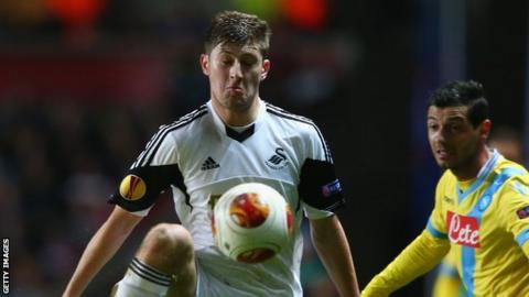 Swansea City's Ben Davies in action against Napoli
