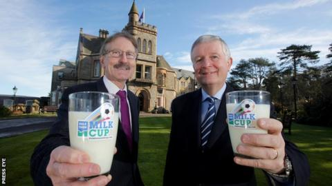 Milk Cup official Victor Leonard and David Dobbin of Dale Farm celebrate the new sponsorship deal
