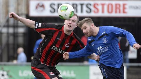 Jordan Owens and Kyle Buckley in action as Crusaders overcome Ballyclare Comrades 5-0 at Seaview