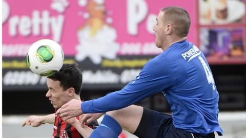 Paul Heatley and Chris Getty in action during Crusaders' convincing victory over Ballyclare