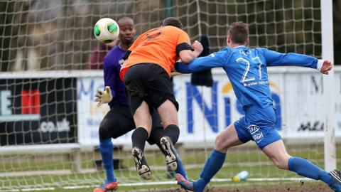 Striker Guy Bates heads home one of his three goals for the Lurgan Blues against the Mallards