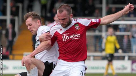 Neil Ashton battles for the ball with Hereford's Dan Walker.