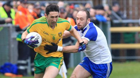 Donegal's Rory Kavanagh peels away from Monaghan's Gavin Doogan during the Division Two Ulster derby clash