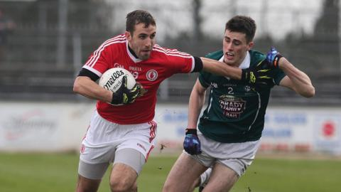 Tyrone's Mark Donnelly shrugs off the challenge of Kildare's Mick O'Grady in the Division Two clash on Sunday