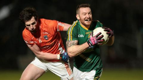 Armagh's Aaron Findon gets to grips with Meath's Michael Burke during the Division Two encounter on Saturday night