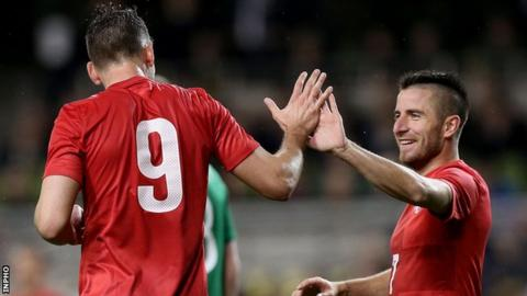 Filip Dordevic celebrates his Serbia winner with team-mate Zoran Tosic