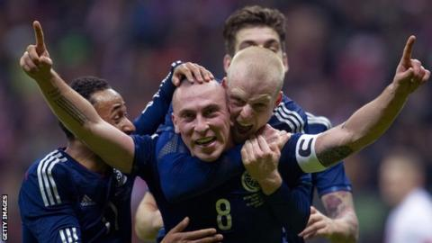 Scotland captain Scott Brown is congratulated on his winner in Warsaw