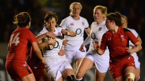 England's Katy McLean is stopped by the Welsh defence during the Women's Six Nations game at the Twickenham Stoop, which the home side won 35-3.