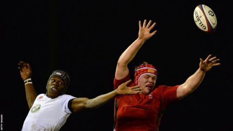 Wales lock Joe Davies is challenged by England's Maro Itoje during the Under-20s Six Nations match at Kingston Park in Newcastle, which ended 67-7 in the home side's favour.