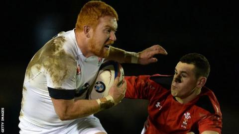 Joel Conlon goes past Wales Under 20's Tom Williams