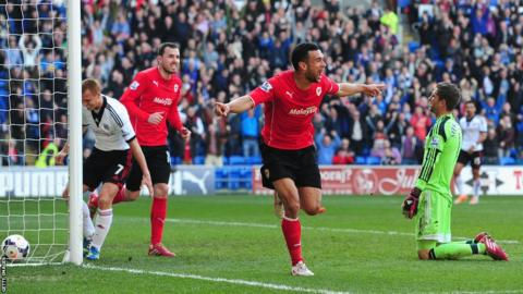 Steven Caulker celebrates after scoring the opening goal for the hosts
