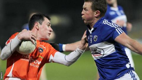 Armagh's Andy Mallon is challenged by Kevin Meaney of Laois