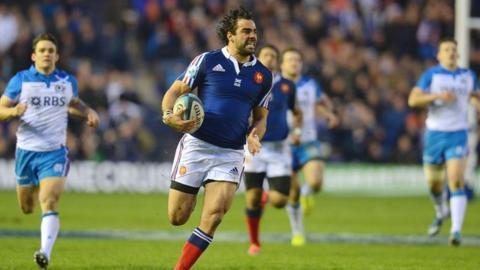 France's Yoann Huget scores against Scotland