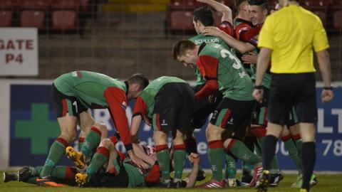 Glentoran celebrated a 3-0 win over Ballymena United at the Oval