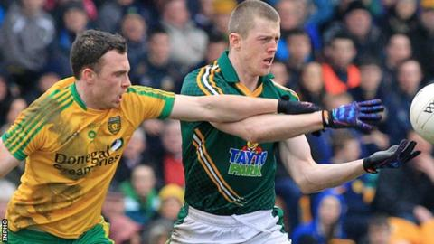 Martin McElhinney of Donegal challenges Meath opponent Kevin Reilly