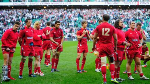 Wales are dejected after their 29-18 defeat and scrum-half Rhys Webb ends his day with his foot in a medical boot