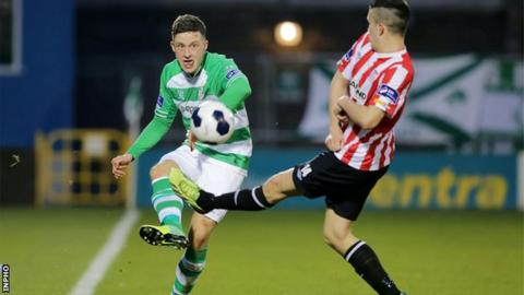 Rovers player Rob Cornwall is challenged by Derry's Michael Duffy