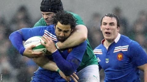 Yoann Huget is tackled by Mike Ross