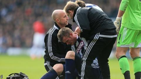 Chris Brunt was injured in his side's 3-0 defeat by Manchester United