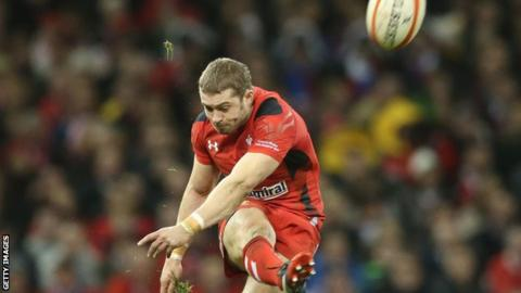 Leigh Halfpenny kicks for goal while playing for Wales
