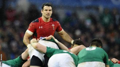 Wales scrum half Mike Phillips looks over the top of the scrum against Ireland