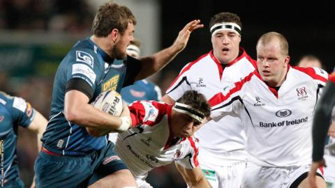 Scarlets' Joe Snyman takes on Ulster's Nick Williams and Callum Black.