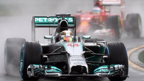 Mercedes driver Lewis Hamilton steals a last-ditch pole position in a thrilling wet qualifying session at the Australian Grand Prix.