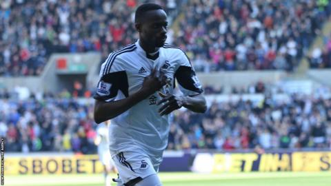 Roland Lamah celebrates after giving Swansea City an early lead in the crucial Premier League match against West Brom at the Liberty Stadium.