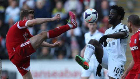 West Brom's James Morrison challenges Swansea City striker Wilfried Bony for the ball.