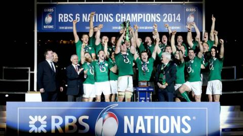 Ireland receive the Six Nations trophy after their dramatic 22-20 win over France at the Stade de France