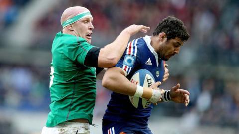 Paul O'Connell challenges Damien Chouly during a keenly contested final Six Nations match of the series