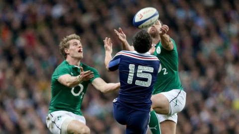 Andrew Trimble and Rob Kearney challenge for a high ball with France full-back Brice Dulin