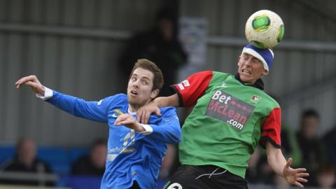 Richard Lecky and Jay Magee in aerial action during Glentoran's 3-0 win over Ballinamallard United