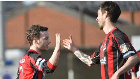Eamon McAllister celebrates his winning goal for Crusaders with team-mate Declan Caddell