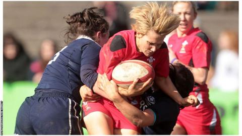 Philippa Tuttiett of Wales is tackled by Scottish defenders Tracy Balmer and Emma Wassell during the Six Nations match at the Talbot Athletic Ground on Sunday. Wales won 25-0