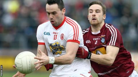 Kyle Coney is challenged by Kevin Maguire at Healy Park