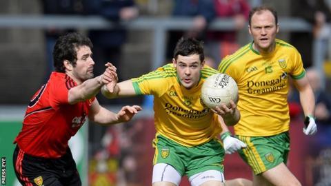 Down's Kevin McKernan challenges Odhran MacNiallais at Pairc Esler