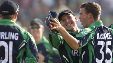 Niall O'Brien congratulates Ireland bowler Andy McBrine after he takes a wicket