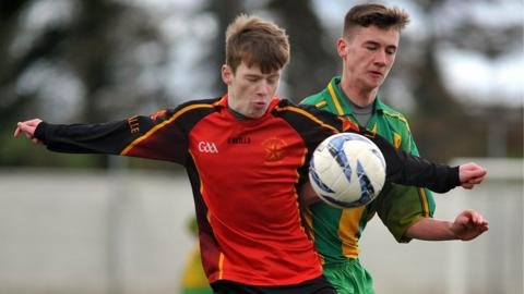 Stephen Erskine of St Mary's competes for possession with De La Salle's Chris McGuinness