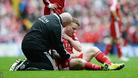 Aberdeen winger Jonny Hayes is injured at Celtic Park