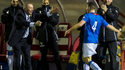 Ally McCoist celebrates with Fraser Aird as Rangers defeat Albion Rovers 2-0