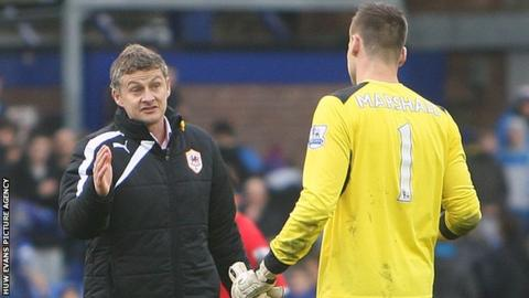 Ole Gunnar Solskjaer with Cardiff keeper David Marshall